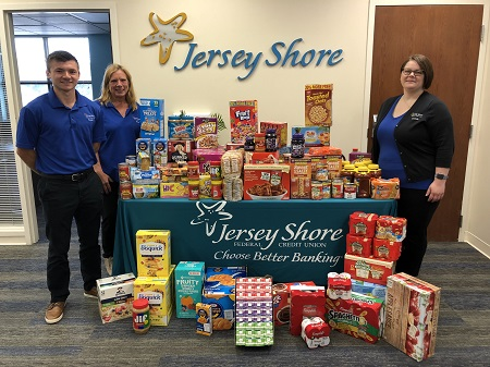 Kid Friendly Food Drive Picture With Staff and Donations