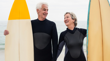 senior couple surfers