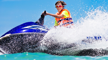 teen riding jetski