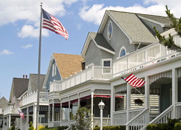 photo of houses with american flags