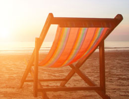 beach chair in front of ocean sunrise