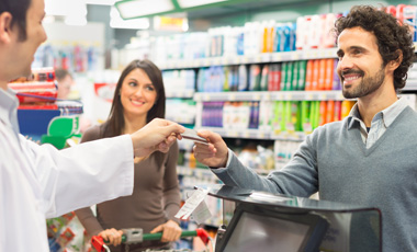 man making purchase in drug store