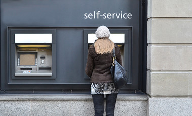woman using outside ATM