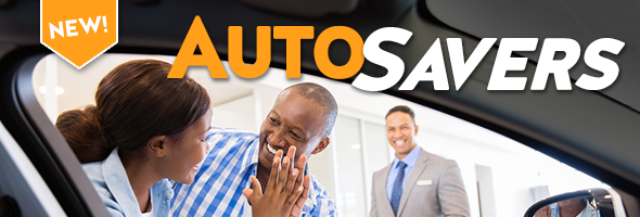 New! AutoSavers. couple looking at new car
